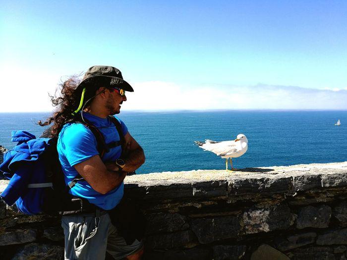 Boy Wind Boy Vs Seagull EyeEm Selects Bird Sea Beach Water Standing Side View Seagull Sky Horizon Over Water