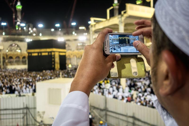 This is the holy Kaaba in Mecca Saudi Arabia, the destination of 1.6 billion muslims in the world. Crow Crowd Islam Ka'aba Makkah Mecca Muslim Saudi Saudi Arabia