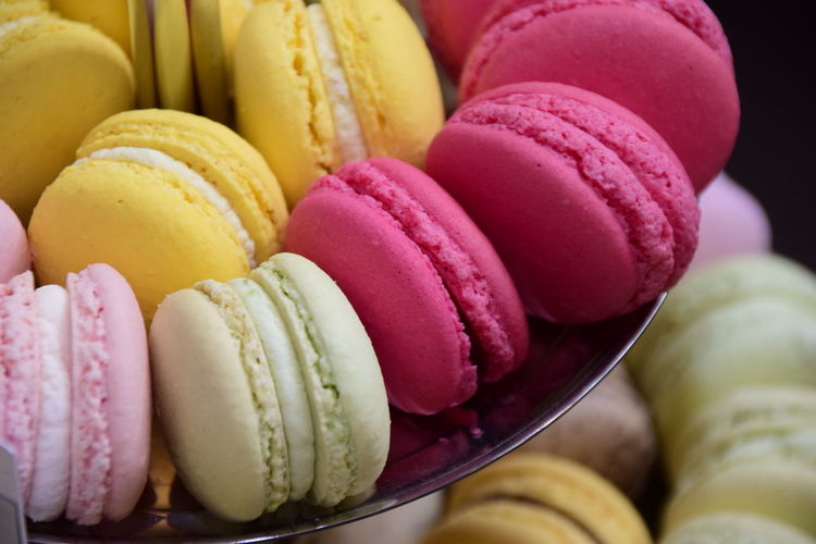 Close-up of colorful macaroons in plate