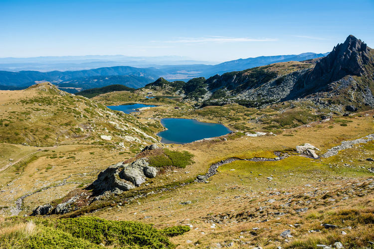 Seven Rila Lakes, Bulgaria The Twin Близнака (Bliznaka) 2,243 m (7,359 ft) 9.1 ha (22 acres) 27.5 m (90 ft) Largest by area The Trefoil Трилистника (Trilistnika) 2,216 m (7,270 ft) 2.6 ha (6.4 acres) 6.5 m (21 ft) Irregular shape and low shores Fish Lake Рибното езеро (Ribnoto ezero) 2,184 m (7,165 ft) 3.5 ha (8.6 acres) 2.5 m (8.2 ft) Shallowest The Lower Lake Долното езеро (Dolnoto ezero) 2,095 m (6,873 ft) 5.9 ha (15 acres) 11.0 m (36.1 ft) Lowest Mountain Scenics - Nature Beauty In Nature Tranquil Scene Environment Landscape Sky Tranquility Non-urban Scene Nature Day No People Mountain Range Idyllic Plant Remote Land Water Cloud - Sky Outdoors Formation Lake Lake View Lakeside Nature Stay Out