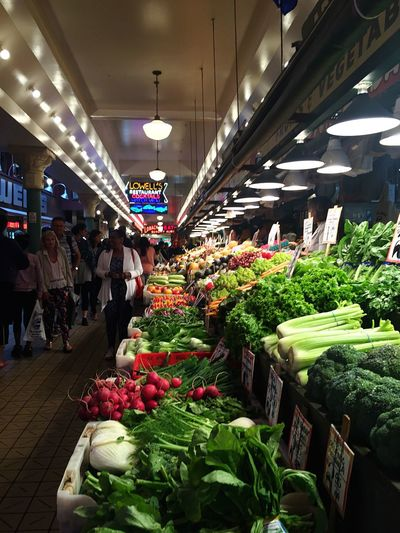 Pike Place Market in Seattle Retail  Store Market Freshness For Sale Flower Outside Market Vegetable Greens Outdoor Market vegetables Pike Place Market September 2016 cConsumerism sSale vVariation cChoice bBuying aArrangement wWomen bBuilt Structure sStreet Market iIndoors  Cellary cCustomer  cCity