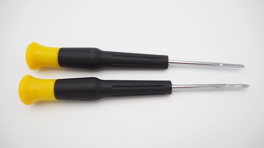 Flat mouth screwdriver and screwdriver on white back ground Black Color Carpentry; Mechanic; Design; Used; Color; Saved; Yellow; Concept; Two Close-up Copy Space Cut Out Flat Mouth Flat Mouth Screwdriver Group Of Objects High Angle View Icon; Black; Closeup; Object; Technology; Work; Metal; Equipment; Construction; Indoors  Industry; Steel; Industrial; Tool; Plastic; Metallic; Handle; Repair; Isolation; Hardware; Fix; Isolated; White; Flat; Screw; Mouth; Background; Flat-blade; Medium Group Of Objects No People Single Object Still Life Studio Shot White Background Work Tool Yellow