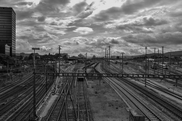 View of railway tracks against cloudy sky