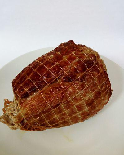 roasted pork roast on a white dish on a white background Roasted Pork Roast Delicious Tasty Meat Food Pig White Dish Plate White Background Roasted Grilled Crusty No People Food White Background Studio Shot Indoors  Close-up