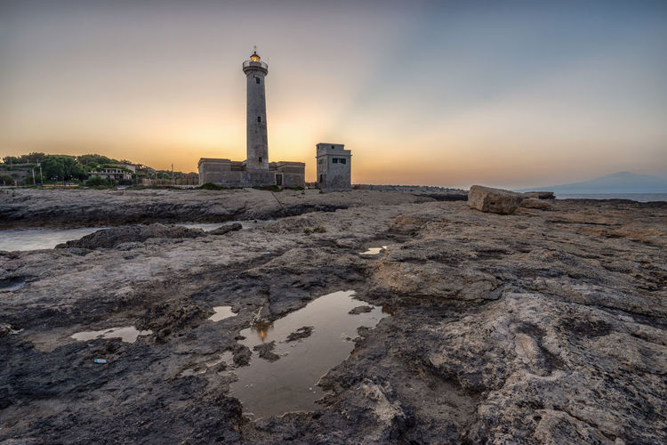 Augusta Sicily Architecture Beach Building Building Exterior Built Structure Cloud - Sky Direction Guidance History Italy Land Lighthouse Nature No People Outdoors Scenics - Nature Sea Sky Sunset Tower Water