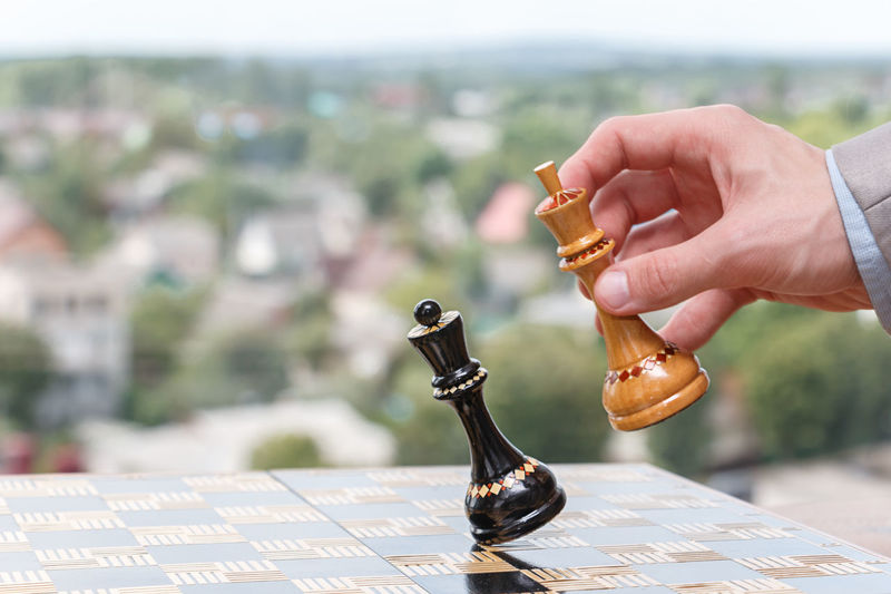 chess pieces on a chessboard Achievement Business Chess Player Chessboard Teamwork Win Achievements Battle Boss Businessman Career Checkmate Chess Chess Board Competition Cooperation Decision Game Goal Mate Play Chess Solution Strategy Success Team Business Strategy Business Meeting Ladder Of Success Finish Line  Winning