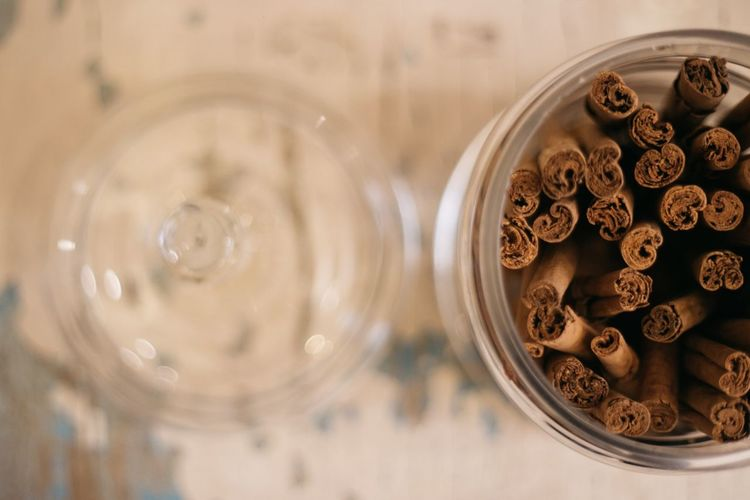 Directly Above Shot Of Cinnamons In Glass Container
