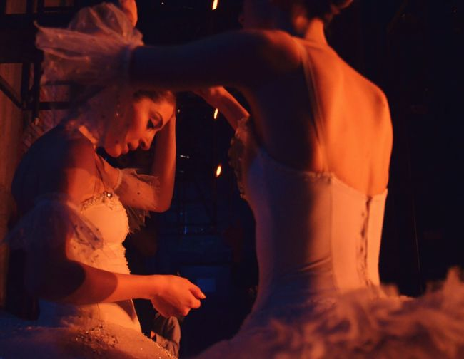 Ballet dancers in dark at backstage
