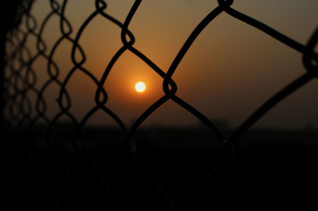 sunset, chainlink fence, protection, security, safety, silhouette, metal, sun, outdoors, sky, no people, nature, beauty in nature, backgrounds, close-up, day