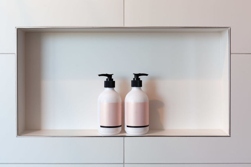 https://cdn.eyeem.Disagreement concept - two liquid dispensers facing away from each other in shower niche with copy space Copy Space Relationship Bottle Concept Conceptual Container Copy Space Disagreement Dispenser Dispute Home Home Interior Indoors  Shampoo Shelf Shower Shower Time Soap Dispenser Still Life White Color