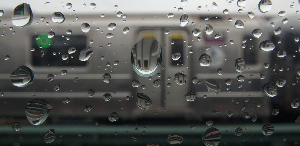 The pieces of broken rain while reflecting the city train. Transportation Drop Water Wet Close-up Mode Of Transport Rain RainDrop Day Indoors  Macro 1cm Photography