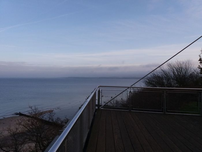 View from a bridge 🎶🎵♩😀 Sea Water Railing Day Outdoors No People Horizon Over Water Sky Nature Beauty In Nature Baltic Sea Showcase: December Ostholstein Tranquil Scene No Edit No Filter Baltic Sea Winter