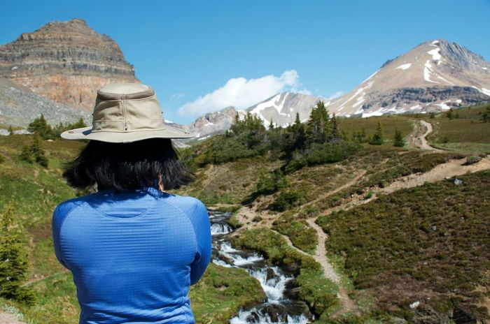 Banff National Park  Canadian Rockies  Climbing Mountains On The Trail Adventure Beauty In Nature Finding A Peaceful Place Landscape Looking At View Mountain Mountain Peak Mountain Range Mountains In Background One Person Outdoors Real People Rear View Travel Destinations Woman Hiking