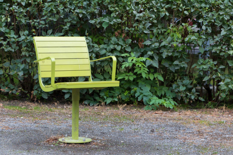 swivel chairs in a park Park Bench Colorful Day Empty Nature No People Outdoors Park Park Chair Revolving Chair Swivel Chair Yellow