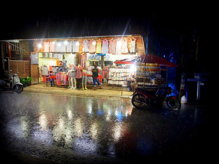 Rain, shops, reflection