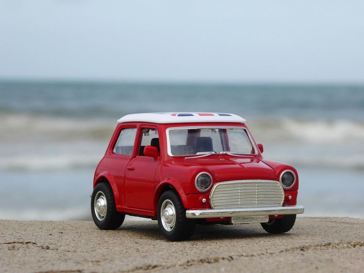 Toys Mini Car Morocco Tanger  London Mini Car Toys Colour Your Horizn EyeEm Selects Red Beach Horizon Over Water Water Sea Accidents And Disasters Rescue Day Sand Outdoors Sky No People Nature