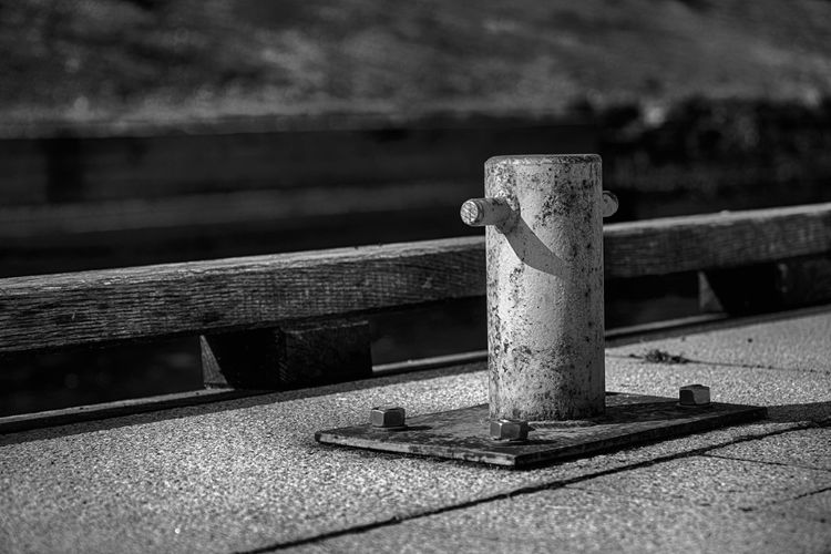 Backgraund Postcard Backdrop Bollard Cleat Close-up Concept Cover Day Design Element Focus On Foreground Ideas Metal Monochrome Nature No People Outdoors Pattern Pier Post Postcards Railing Screw Selective Focus Strength Sunlight Textured  Urban Water Wood - Material