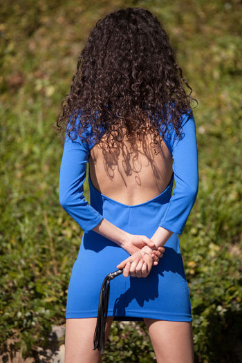 Girl with a blue skirt and a little whip Adult Beauty Blue Casual Clothing Child Children Only Close-up Day Girl Grass Holding Human Body Part Legs Nature One Person Outdoors People Skinny Skirt Sport Tree Whip Wip Wipped Woman