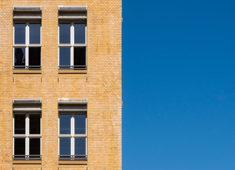 Brick Building Minimalistic Minimalobsession Minimalism Window Architecture Built Structure Building Exterior Blue Building Clear Sky Copy Space Low Angle View Residential District Sky House Sunlight Glass - Material Wall - Building Feature Reflection No People