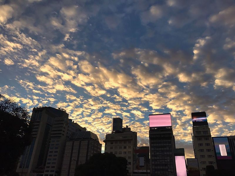 Buildings Cityscape Capital Cities  Advertising Screen Clouds And Sky Cotton Clouds Dramatic Architecture Building Exterior Built Structure Skyscraper Sky Low Angle View City Cloud - Sky Modern No People Outdoors Day Cityscape