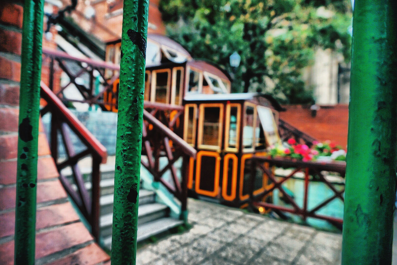 day, metal, focus on foreground, no people, outdoors, architecture, playground, built structure, nature, selective focus, park, plant, transportation, wood - material, tree, outdoor play equipment, close-up, mode of transportation, park - man made space, jungle gym, wheel