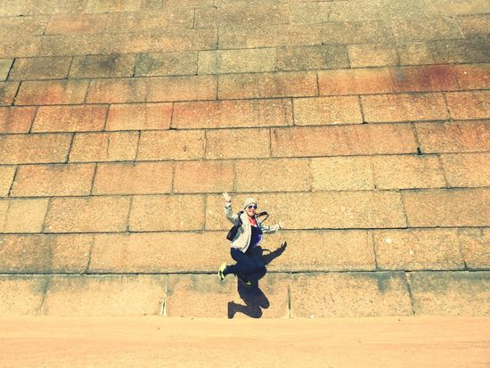 Dauther👧 Real People Day Sunny Day 🌞 Jumping Jump Happy Girl  Flying High Summer Memories 🌄 Beachphotography Petropavlovskayafortress Sunlight Beach River Neva EyeEmNewHere The Week On EyeEm Embankment Colors Of Sankt-Peterburg Sankt-Petersburg Russia Paint The Town Yellow