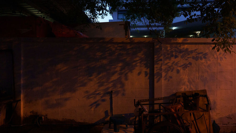Shadow of abandoned building on wall at night