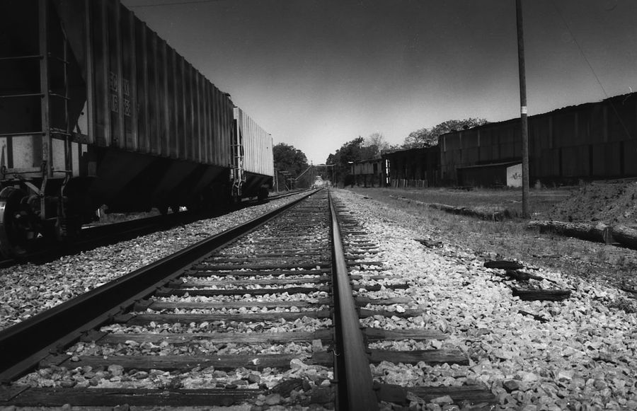 Architecture Day Diminishing Perspective Direction Film Photography Freight Train Freight Transportation Gravel Long Mode Of Transportation Nature No People Outdoors Public Transportation Rail Transportation Railroad Track Shunting Yard Sky The Way Forward Track Train Train - Vehicle Transportation vanishing point