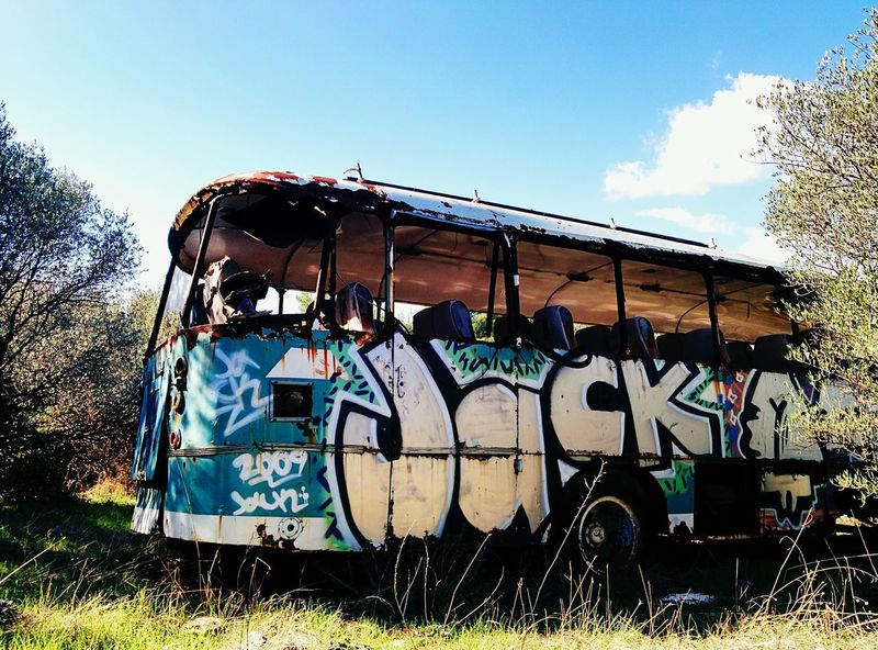 Graffiti Spray Paint Text Outdoors No People Sky Day Fame Abandoned Bus Flat Tyre Trees Trees And Sky Greece Penteli Nature Takes Over Nature Stationary Clear Sky Abandoned Transportation Land Vehicle Bus Athens, Greece Athens Tree