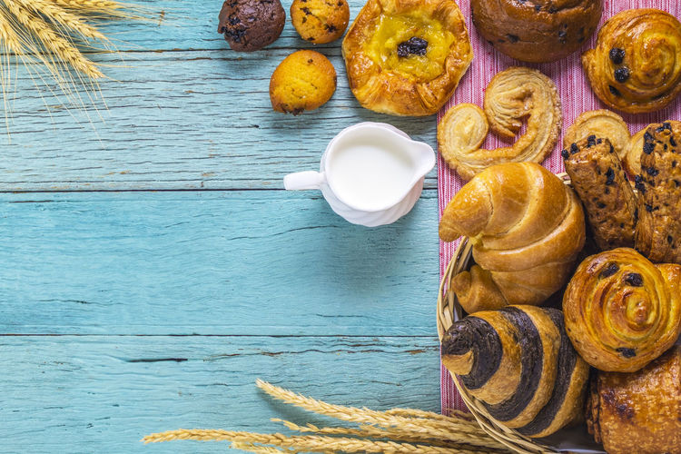 Close-up of croissants with pitcher on table