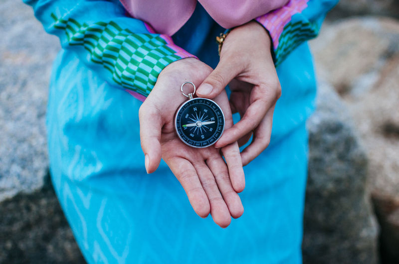 Compass in hand Adult Close-up Day Focus On Foreground Holding Human Body Part Human Hand Men Midsection Navigational Compass One Person Outdoors People Real People Time Watch Women