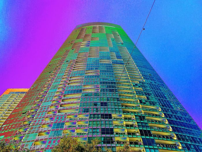 Architecture Blue Building Building Exterior Built Structure City Clear Sky Day Financial District  Low Angle View Modern Multi Colored Nature No People Office Office Building Exterior Outdoors Sky Skyscraper Tall - High Tower Various Colors