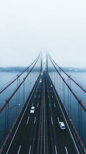 High angle view of bridge over sea during foggy weather