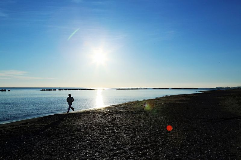 Live For The Story Sea Water Beach Horizon Over Water Tranquil Scene Beauty In Nature Nature Tranquility Scenics Sky Full Length One Person Real People Outdoors Clear Sky Day People Silhouette Men Leisure Activity Sea And Sky Sea City Sun Sunrise The Week On EyeEm