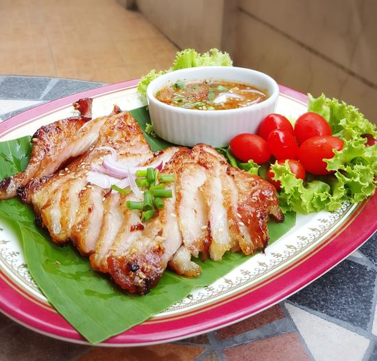 Thai style pork grilled and spicy dip Ready-to-eat Plate Food And Drink Food Healthy Eating Garnish Indoors  Close-up Appetizer Serving Size Meal Freshness Eyemselects Pork Bbq Barbecue Pork Barbecue Pork Grill Thaifoods ThaiFoodGoodTaste Thaifood Restaurant