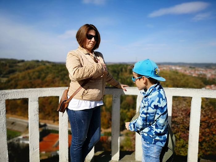 Two People Child Family Togetherness Childhood Females Men Women Casual Clothing Sky Girls Boys Males  Adult Standing Emotion Leisure Activity Fence Offspring Outdoors