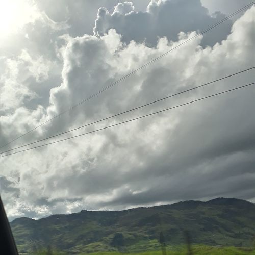 Mountain Cloud - Sky Car Landscape Travel Dramatic Sky No People Road Trip Travel Destinations Beauty In Nature Nature Mountain Range Grass Vacations Scenics Day Photography Themes Rural Scene Outdoors Sky