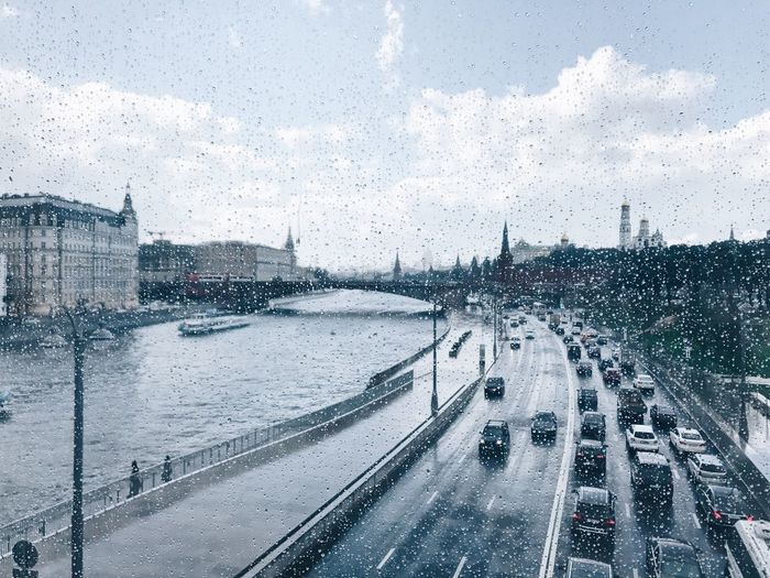 Rainy day in Moscow City Silhouette Rainy Days☔ Rainy Day Rain In The City Flying Bridge Zaryadye Zaryadye Park Russia Moscow Worldcup2018 World Cup 2018 Transportation Water Wet Car Drop Mode Of Transportation Glass - Material Transparent Rain Road City Nature Sky No People RainDrop