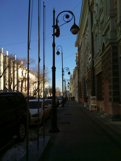 Street in city against clear sky