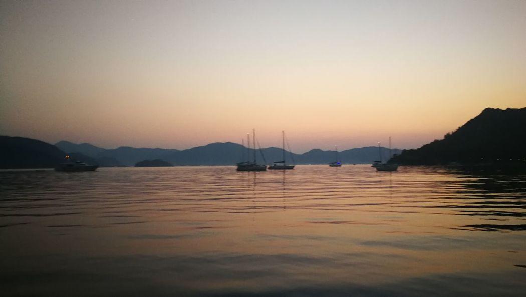 EyeEm Selects Water Nautical Vessel Mountain Sunset Sailboat Lake Reflection Mast Yacht Sky