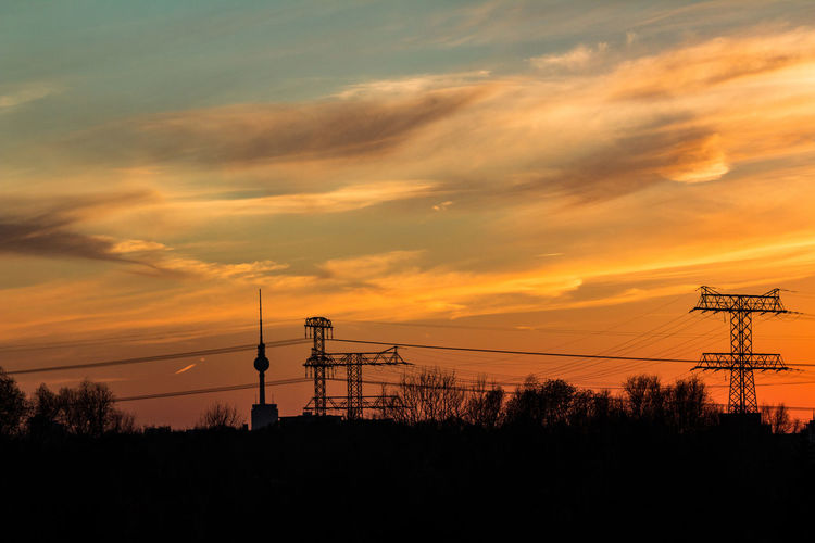 Sunset Sky Cloud - Sky Silhouette Connection Electricity  Orange Color Technology Cable Power Line  Beauty In Nature Power Supply Electricity Pylon No People Nature Fuel And Power Generation Plant Scenics - Nature Tree Outdoors Telephone Line