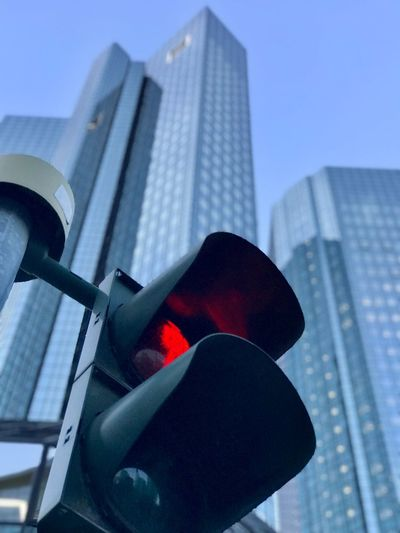 Jay walking 🚶♂️ Iphonephotography City Germany Frankfurt Jay Walking Low Angle View Built Structure Architecture Building Exterior Traffic Signal Stoplight Red Light Red No People Day City Outdoors Skyscraper Clear Sky Road Sign Close-up Sky