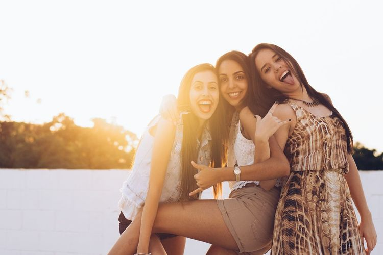 Friends and the sunset. Women Friendship Happiness Sunlight Beauty