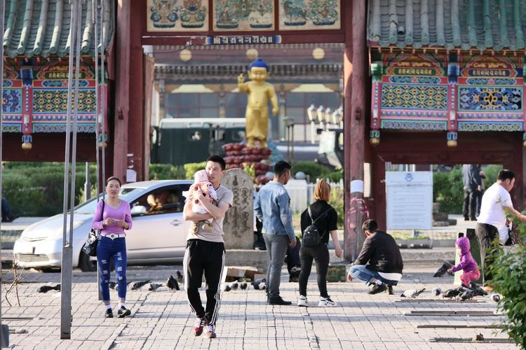 Baby Family Street City Men Women Togetherness Architecture Building Exterior Built Structure Place Of Worship