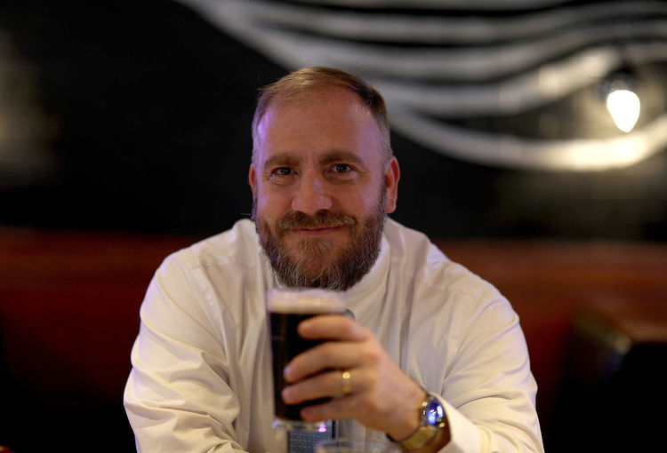 A middle-aged well-dressed white male holds a stout beer at a bar. Beer Guinness Illinois Suit Well Dressed Alcohol Alcoholic Drink Bar Businessman Cheers Craft Beer Drink Drinking Glass Irish Middle Aged Man Smile Tavern  Watch Moments Of Happiness