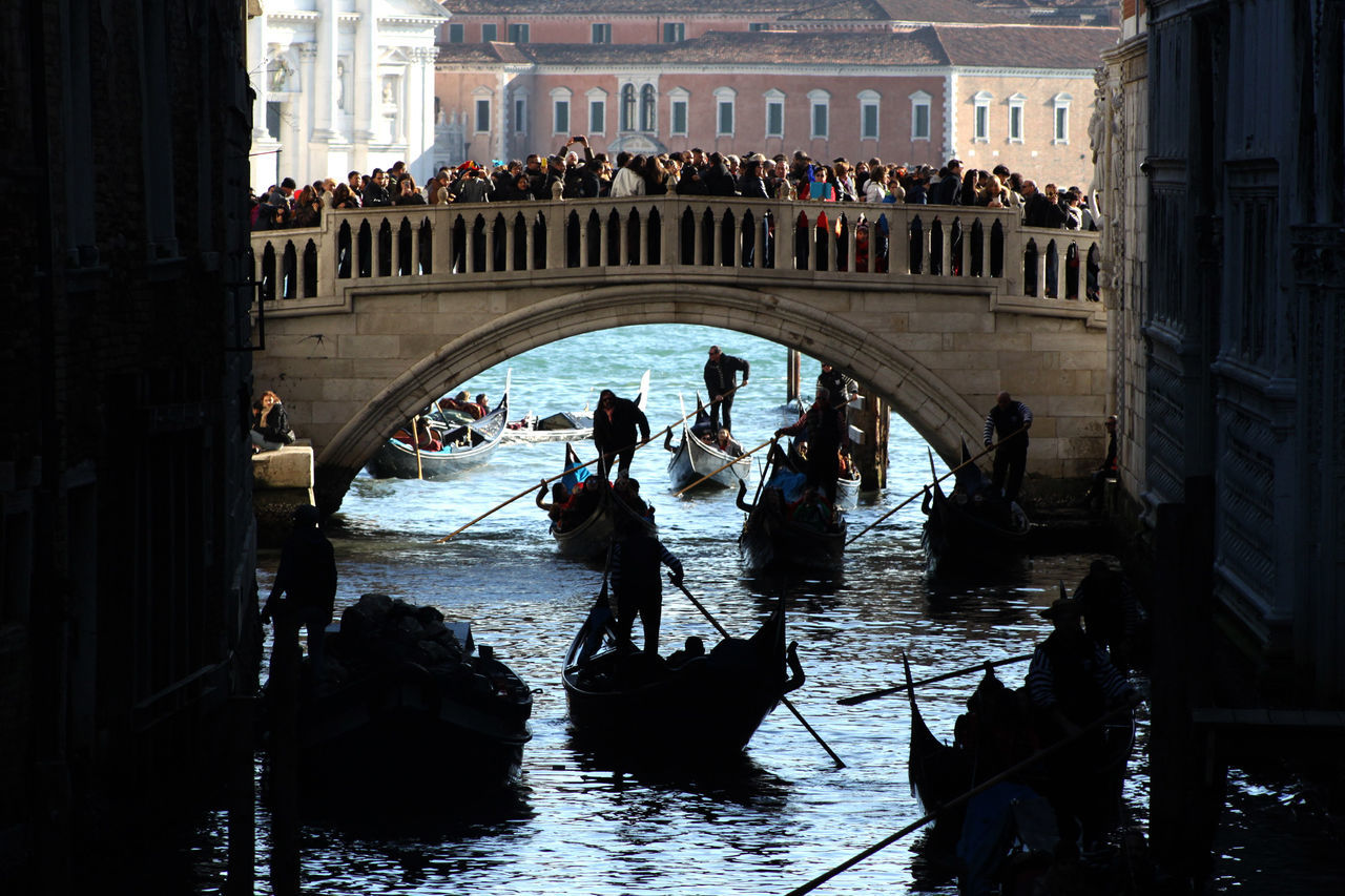real people, water, architecture, large group of people, bridge - man made structure, built structure, gondola - traditional boat, gondolier, silhouette, travel destinations, women, day, nautical vessel, lifestyles, men, outdoors, rowing, adult, people