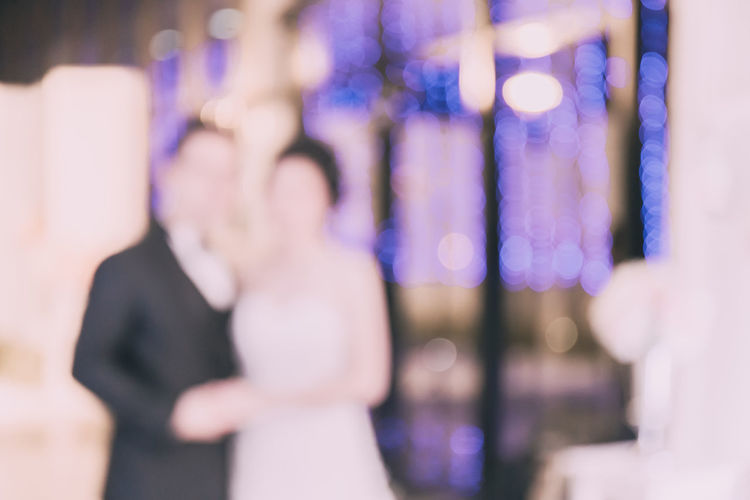 Blur the image of the bride and groom at the wedding at night. Blurred Love Wedding Blur Bridegroom Happiness Love Night Not Clear Real People Symbol Of Love Togetherness Two People