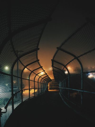 View of illuminated tunnel at night