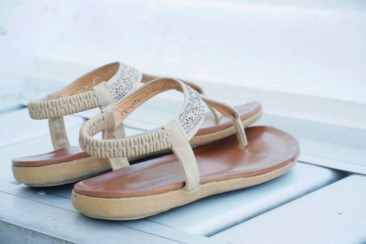 Close-up of sandals on shelf