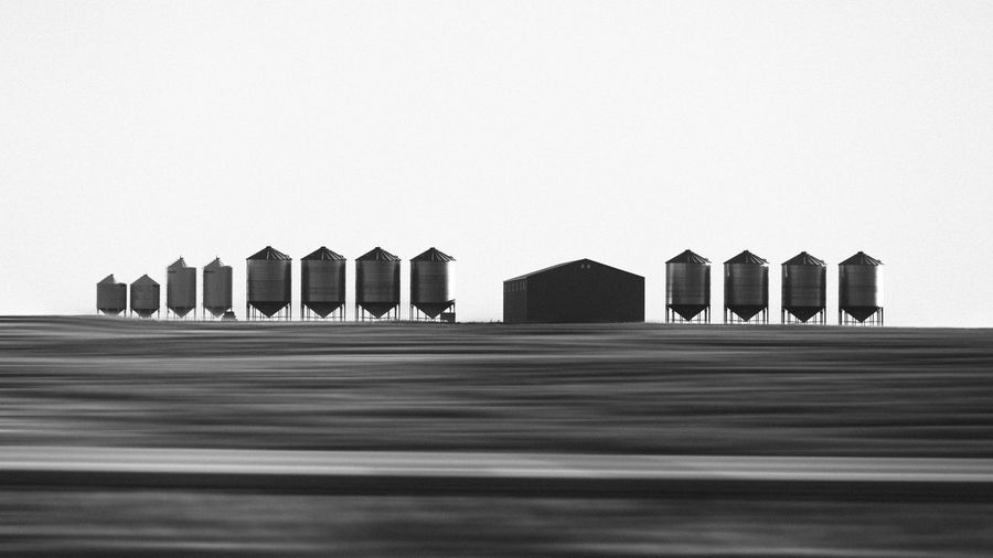 Collection of Black and white photographs during a road trip from Ontario to British Columbia in Canada. Timeless Architecture Black And White Blackandwhite Blurred Motion Bnw Bnw_collection Building Building Exterior Built Structure Canada Clear Sky Countryside Day Field In A Row Industry Landscape Monochrome Motion No People Outdoors Roadtrip Side By Side Sky